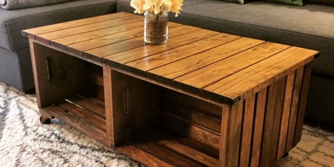 Our DIY wood crate coffee table! How we did it: We used 4 wood crates from a cra...
