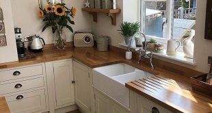Natural wood counter tops with white cupboards & dark drawer pulls. - #counter #...